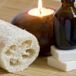 Стоковое фото: Aromatherapy Candle and Massage oil in Zen Style Spa