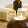 Stock Photo: Aromatherapy Candles and Massage oil in Home SPA