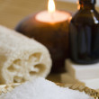 Foto Stock: Bath salt, Aromatherapy Candles and Massage oil in Home SPA