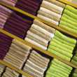 Stock Photo: Multicolored Towels on Wooden Shelves
