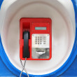 Red pay-phone on wall — Stock Photo #48563801