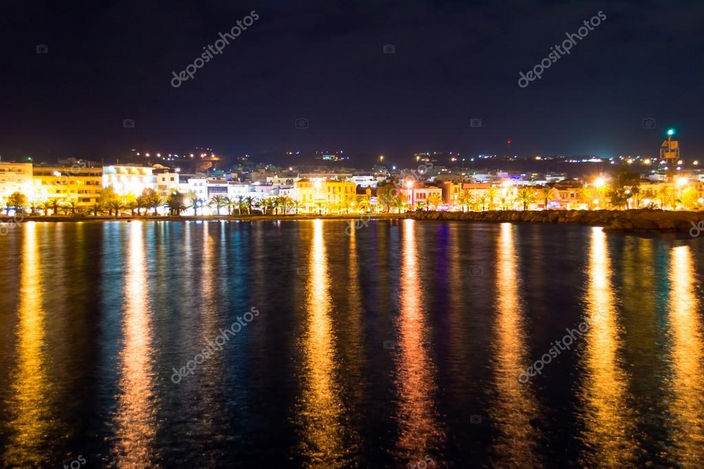 Night view of city of Rethymno in Crete in Greece, with a reflection on sea — Stock Photo #15364011
