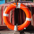 Life belt on a boat — Stock Photo