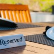 Reserved sign on a table — Stock Photo #42885637