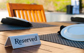 Reserved sign on a table — Stock Photo