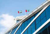 Two UAE flags on modern building. — Stock Photo