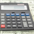 Calculator with money — Stock Photo #1036751