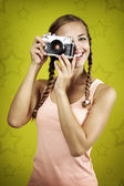 Young girl taking photo with retro camera — Stock Photo