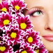 Beauty face of woman with chrysanthemum - Stockfoto