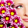 Beauty face of woman with chrysanthemum - Stock Photo