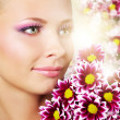 Beautiful girl with chrysanthemum — Stock Photo