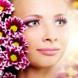 Beautiful girl with chrysanthemum - Stockfoto