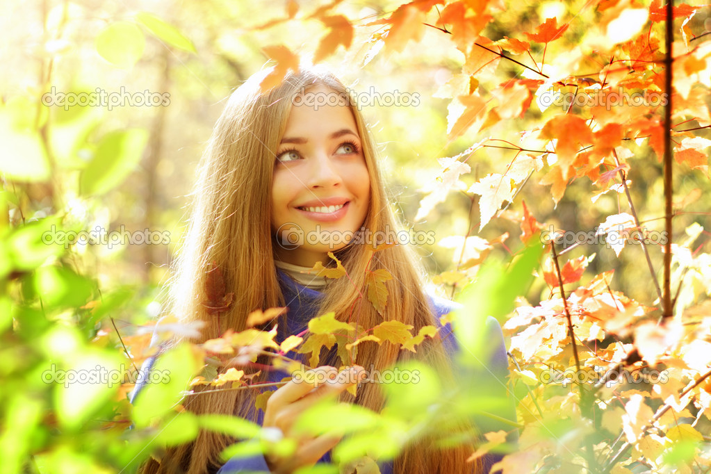 Portrait of a beautiful girl in autumn forest  Stockfoto #13211457