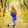 Portrait of a beautiful girl in autumn forest - Stock Photo