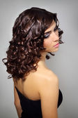 Sexy young woman with curly hair — Stock Photo