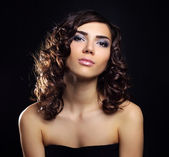 Sexy young woman with curly hair on black background — Stock Photo