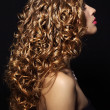 图库照片: Portrait of beautiful girl with curly hair