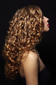 Portrait of a beautiful girl with curly hair — Stok fotoğraf