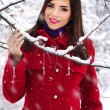 Beautiful elegant woman in red coat — Stock Photo #14435165