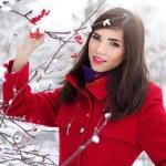 Beautiful elegant woman in red coat — Stock Photo #14746663