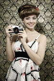 Retro style. Smiling girl with camera — Stock Photo