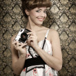 Pin-up Girl mit retro-Kamera — Stockfoto