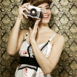Pin up girl with retro camera — Stock Photo