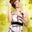 Retro style. Beautiful girl with makeup brushes — Stock Photo #15598405