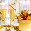 Glasses of champagne with gift box — Stock Photo #16500403