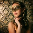 Beautiful girl in carnival mask — Stock Photo