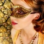 Beautiful girl in carnival mask — Stock Photo #20391449