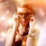 Beautiful girl in carnival mask — Stock Photo #20391463