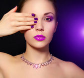 Makeup and manicure. black background — Stock Photo