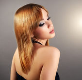 Sensual girl with straight hair and beautiful makeup — Stock Photo