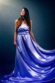 Beautiful girl in violet long dress — Stock Photo