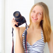 Attractive girl with digital camera — Stock Photo #23200706