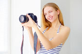 Attractive girl with digital camera — Stock Photo