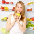 Beautiful smiling girl near the refrigerator — Stock Photo