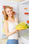 Girl near the refrigerator — Stock Photo
