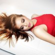 Elegant girl lying on the couch — Stock Photo