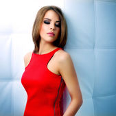 Sensual girl in red dress with beautiful make-up — Stock Photo