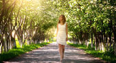 Girl walking in the park — Stock Photo