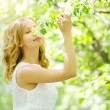 Young girl near the apple tree - Stock fotografie