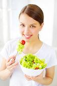Teenager girl eating salad — Stock Photo