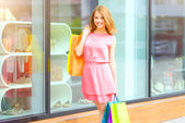 Smiling girl with shopping bags — Stock Photo