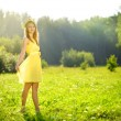 Young attractive girl on a green meadow — Stock Photo