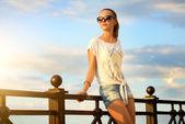 Beautiful fashion girl in sunglasses — Stock Photo