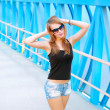 Portrait of a beautiful fashionable girl in sunglasses — Foto Stock