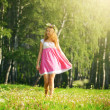 Girl walking on meadow — Stock Photo