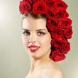 Portrait of smiling girl with red roses hairstyle — Stock Photo